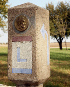 Lincoln Highway Marker with an Abraham Lincoln Medallion and red, white, and blue Lincoln Highway logo